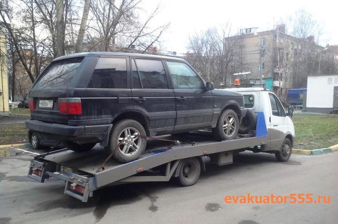 Эвакуатор 555 услуги недорогой эвакуации по москве, эвакуатор везет   Land Rover, лэнд ровер
